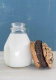 Vertical Varied Cookies Leaning Against Milk Bottle Stock Photo