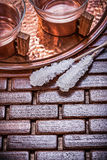 Vertical version of coppery tray tea cups sugar Stock Photos