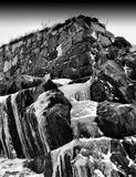 Vertical vibrant black and white frozen waterfall Stock Images