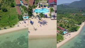 Vertical Video for Social Media Applications on Mobile Devices. Aerial View of Residental Area with Luxury Beachfront. Villas by the Sea on Tropical Island in stock video footage