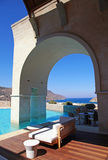 Vertical view of arch pool terrace on summer resort (Greece) Royalty Free Stock Photo