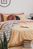Vertical view of books in foot of king size bed with yellow duvet and ginger pillows stock images