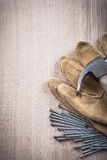 Vertical view of claw hammer leather protective gloves and steel Stock Photos