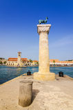 Vertical view for deer statue in entry to Mandraki harbor Stock Image