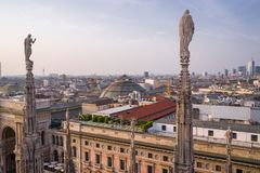 Vertical view from the Duomo rooftop of the Palazzo Settentrionale at sunset. The impressive rooftop view of the city of Milan is even more stunning at sunset royalty free stock photos