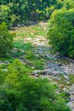Vertical View of the Low Water Level of the Roanoke River. Roanoke River seasonal low water level from the lack of rainfall located in the Blue Ridge Mountains stock image