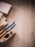 Vertical view of lump hammer shaving plane metal chisels and woo Stock Photo