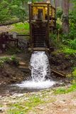 Vertical view on an old water mill in the mountains of the Altai stock photos