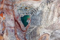 Vertical view of Open Pit Mining. Brilliant colors explode in a vertical view of an open pit mining from above Royalty Free Stock Images