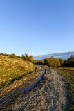 Vertical view over rural road in autumn landscape. Mountain rura Royalty Free Stock Images