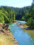 VERTICAL VIEW OF SCENIC BLUE OREGON RIVER Stock Photography