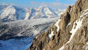 Vertical view of snowy mountain ridge with glacier on top, Alps stock footage