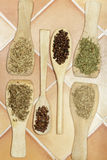 Vertical view of spices in wooden palettes and spoons Stock Photo