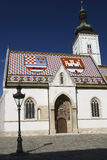 Vertical view of St. Marks' church in Zagreb, Croatia. It is one of the most beautiful and oldest buildings in the city, originally built in the 14th century Stock Photos