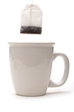 A vertical view of a teabag over a white cup Stock Photography