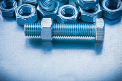 Vertical view of threaded screw nuts and bolts on Royalty Free Stock Photo