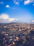 Vertical view from the top from a height of a beautiful tourist city with buildings and houses, roofs of trees and plants, nature stock image