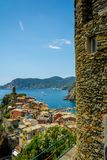 Vertical View of the Town of Vernazza on blue Sea and the Coastline of the Liguria Background. royalty free stock photography