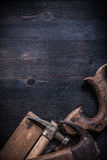 Vertical view of vintage square ruler claw hammers hand saw Royalty Free Stock Image