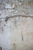 Vertical view of weathered concrete and stucco colonial wall in. Asia with large horizontal crack running across. The chipping and erosion are due to the age Royalty Free Stock Photography