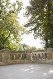 Stone balcony with trees in background Royalty Free Stock Image