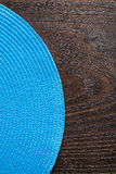 Vertical view wickered round mat on vintage wooden Stock Images