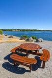 Vertical view for wooden benches on sea coast Royalty Free Stock Photos