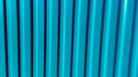 Vertical vivid aqua green tilted blur lines abstraction Stock Photography