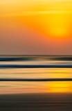 Vertical vivid orange motion blur ocean landscape abstraction Royalty Free Stock Images