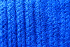 Vertical wales on bright blue handmade knitted fabric Royalty Free Stock Photography