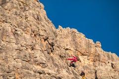 Vertical walls with climber Cinque Torri Stock Photo