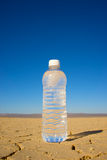 Vertical Water Bottle in Desert Stock Photo