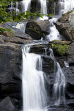 Vertical Waterfall. Time exposure creates the blur in the water at this large multi-tiered waterfall stock image