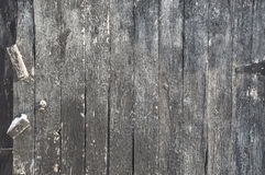 Vertical weathered painted black wooden boards background with h. Background landscape oriented image of some vertical grunge black painted crackled and peeling royalty free stock image