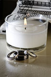 Vertical: Wedding Rings, White Candle, Table Decor Stock Photography