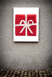 Vertical White Board and Red Gift Box, On Grungy Gray Wall Stock Photography