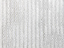 Vertical White Knitting or Knitted Fabric Texture Pattern Backgr. White knitting or knitted fabric texture pattern background. Knitting or knitted. White Royalty Free Stock Images