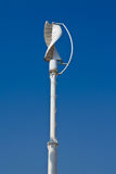 Vertical wind turbine. Against blue sky Royalty Free Stock Images