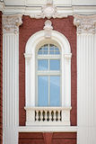 A vertical window with columns. Architectural detail. Stock Photos