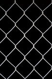 Vertical wire grid window. Wire grid window over block background stock photography