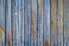 Vertical wood plank fence close up. Detailed background photo. Stock Photos