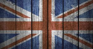 UK flag wood background. Vertical wood planks with an overlay of the flag design of the United Kingdom Stock Images