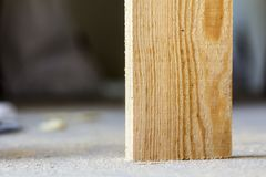 Vertical wooden board close-up detail with blurred background Stock Photo