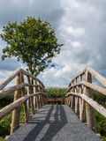 Vertical of wooden bridge with arrows Royalty Free Stock Photo