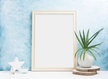 Vertical wooden Photo frame mock up with plants in vase, ceramic decor on shelf. Scandinavian style. Text space royalty free stock photos