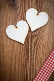 Vertical wooden plank with two lovely hearts Royalty Free Stock Photo