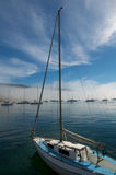 Vertical yacht with mast stock photography