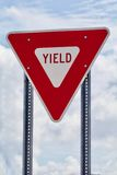Vertical yield sign. Red and White Yield Sign stock photography