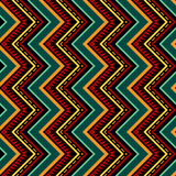 Vertical Zigzag Tribal Seamless Pattern. Seamless geometric vertical ornament in bright contrast colors. Abstract tribal background. Decorative zigzag texture Stock Photos