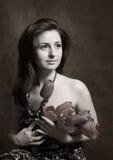 Verticale avec des fleurs de source Photos libres de droits